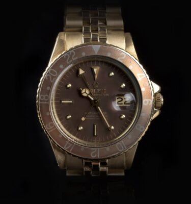 Photo of Immaculate Rolex GMT 1675 18k Gold Nipple Dial Faded Bezel
