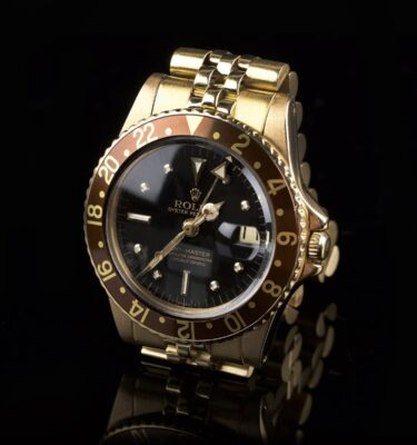 Photo of Stunning Rolex GMT 1675 18k Gold Nipple Dial Tobacco Bezel