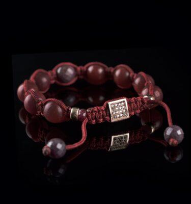 Foto af rubin og rosaguld armbånd