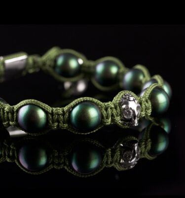Photo of mother of pearl beads and skull bracelet.
