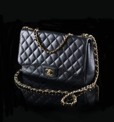 Photo of Chanel Jumbo Classic Flap Black Caviar Golden Hardware