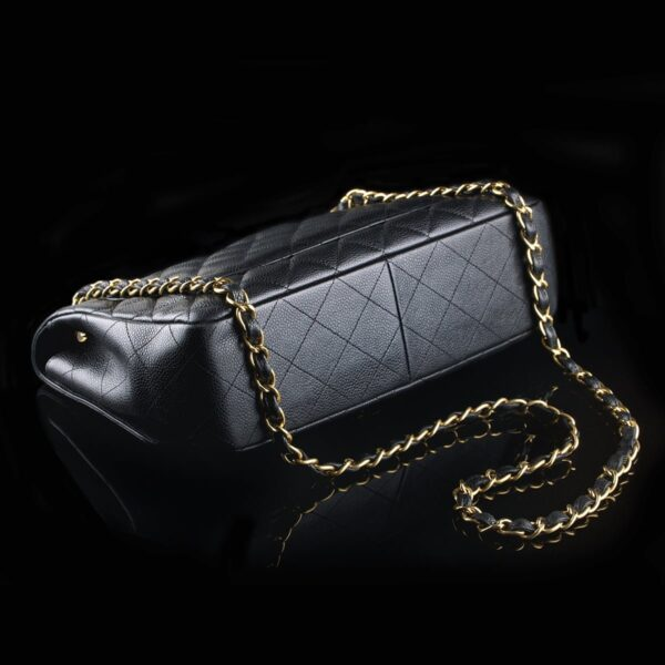 Photo of Chanel Jumbo Classic Flap Black Caviar Golden Hardware