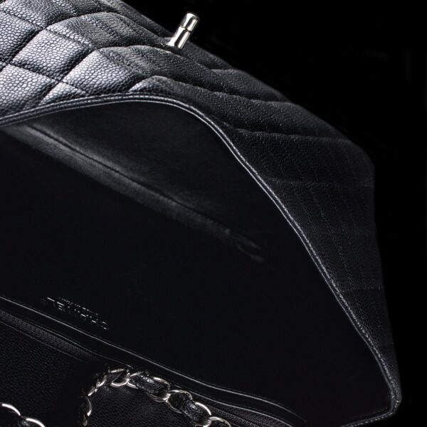 Photo of Chanel shoulder bag model Maxi black quiltet Caviar skin