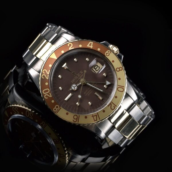 Photo of Rolex GMT-Master Gold Steel 1675 Nipple Dial