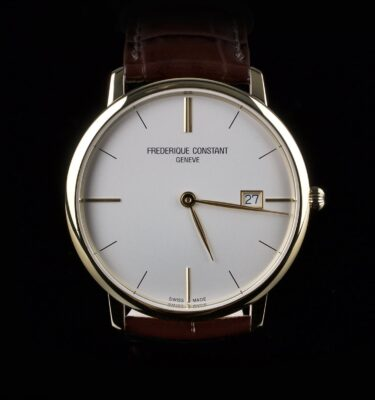 Photo of Frederique Constant golden steel watch with white dial and brown leather strap