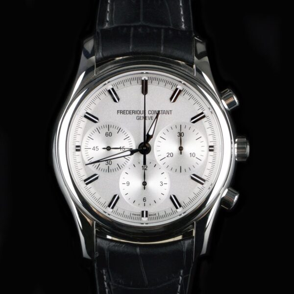 Photo of Frederique Constant steel watch with white dial and black leather strap