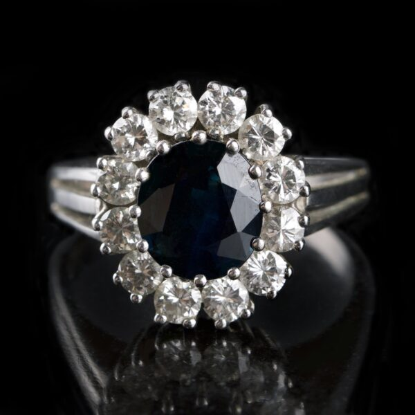 Photo of rosette ring with sapphire and diamonds