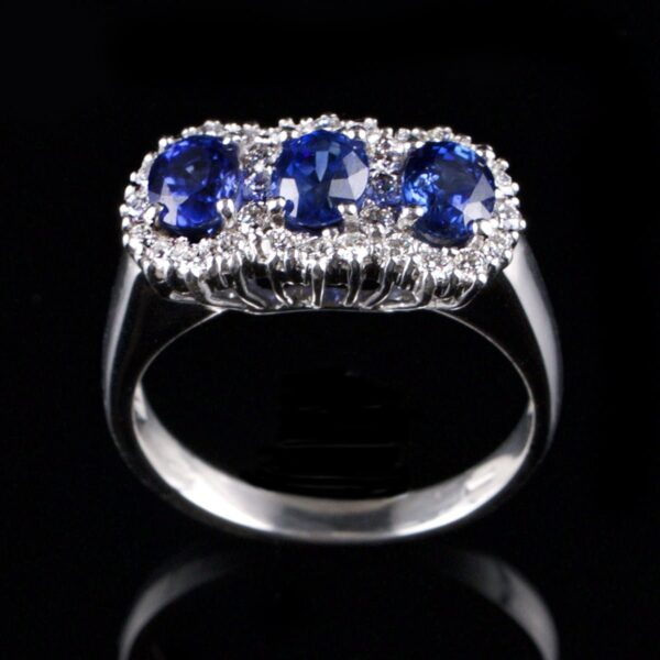 Photo of ring with 3 sapphires and 30 diamonds
