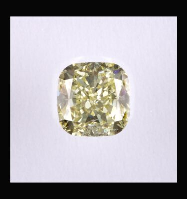Photo of diamond cushion fancy light yellow