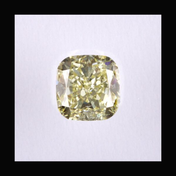 Photo of diamond cushion fancy light yellow