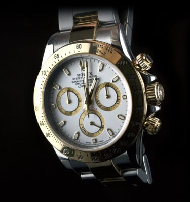 Photo of watch Rolex Daytona ref 116523 gold steel white dial